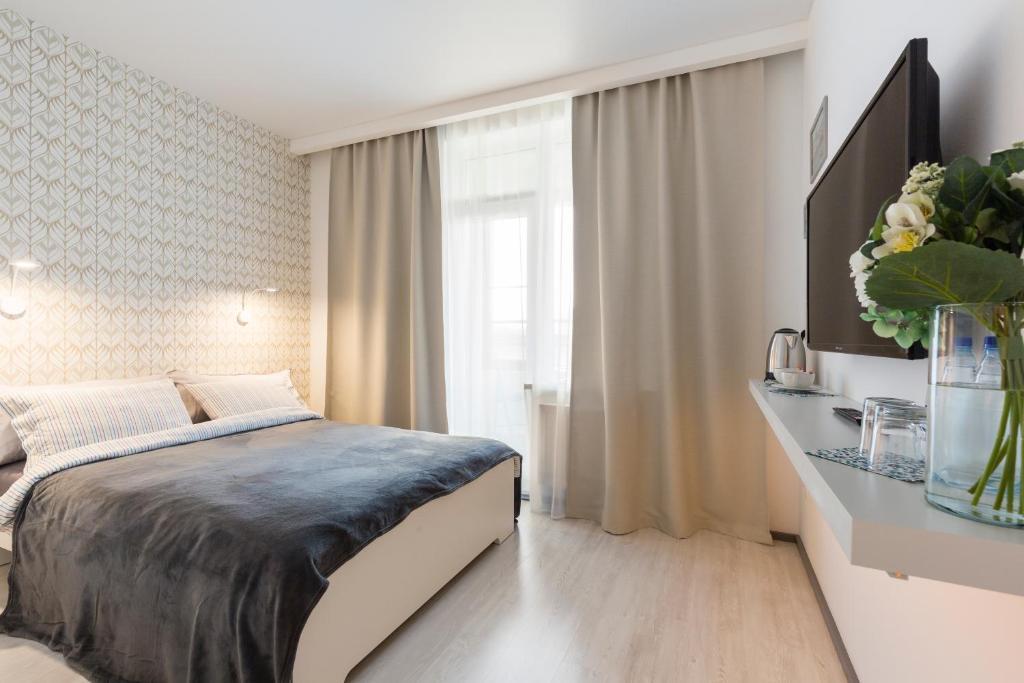 Кровать или кровати в номере Guesthouse MyInn