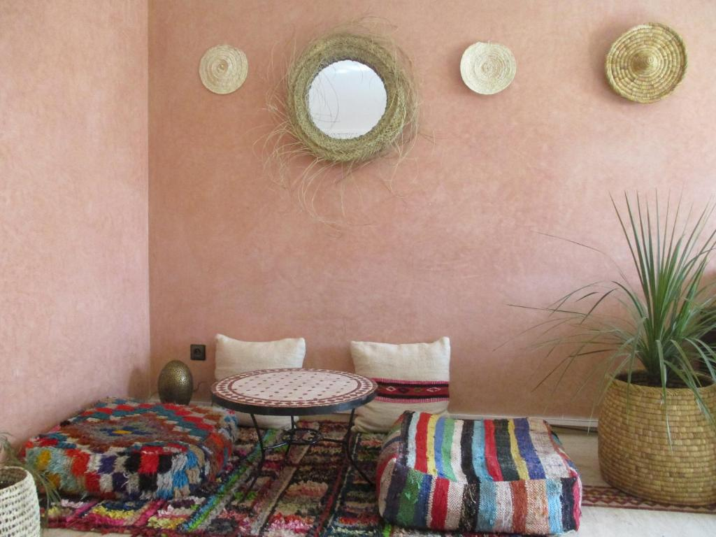 A seating area at At Home Marrakech with swimming pool