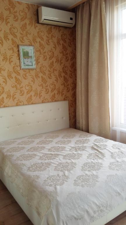 Кровать или кровати в номере Apartment on ulitsa Roz 115 / 1