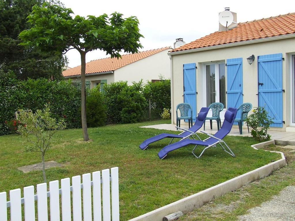 Une sympathique maison de vacances aux volets bleus