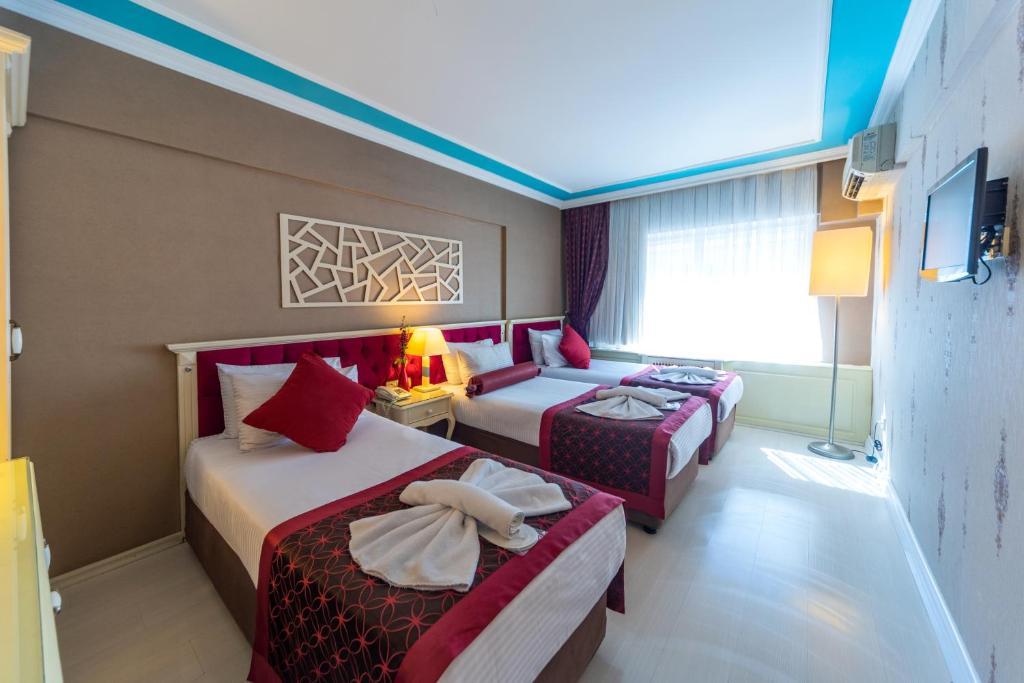 Säng eller sängar i ett rum på Viva Deluxe Hotel
