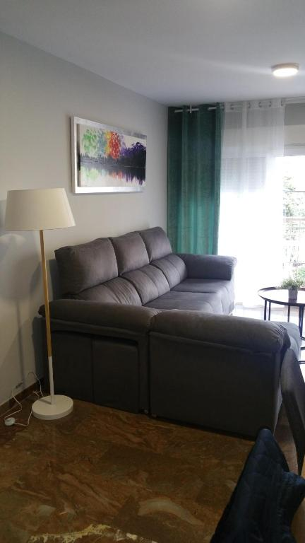 A seating area at SAUCES Alojamiento con PARKING-GRATIS