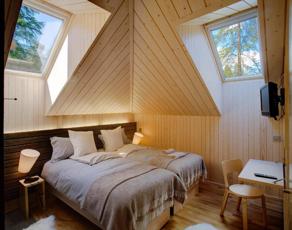 Vuode tai vuoteita majoituspaikassa Halla Nature & Design Villas