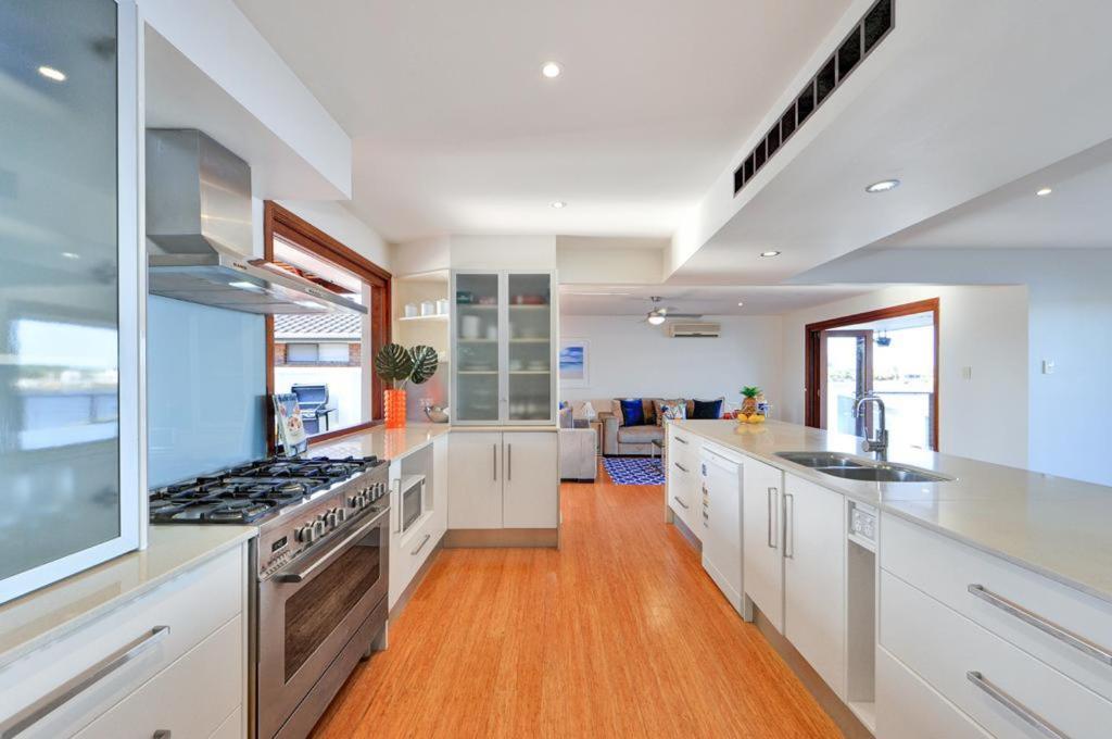 A kitchen or kitchenette at Mermaid Island Beach House