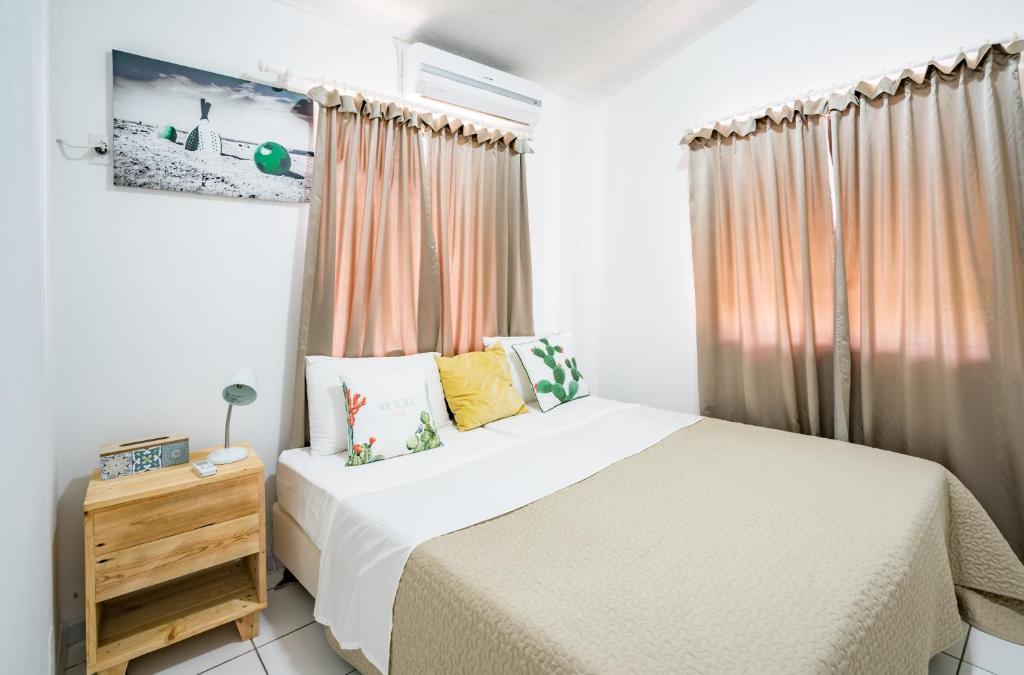 Cama ou camas em um quarto em Orchidia 69 apartments