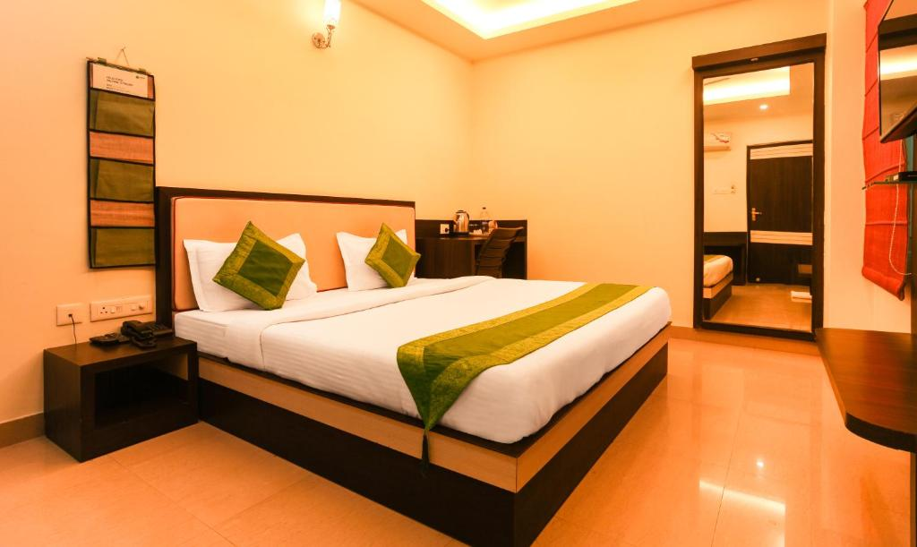 A bed or beds in a room at Hotel Janki International By Keymagics