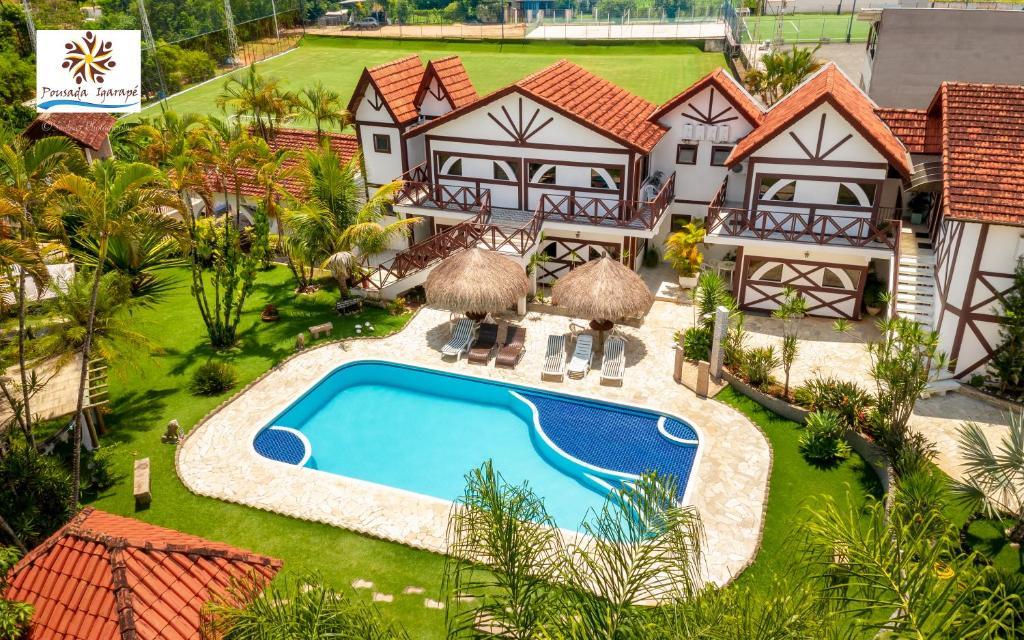 Uma vista da piscina em Pousada Igarapé ou nos arredores