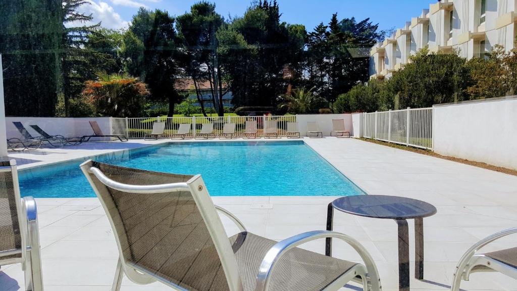 The swimming pool at or near Novotel Narbonne Sud A9/A61