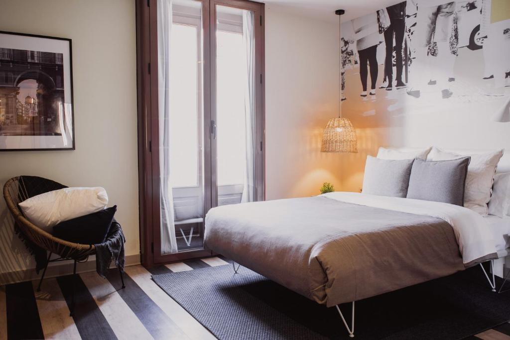 A bed or beds in a room at room007 Select Sol