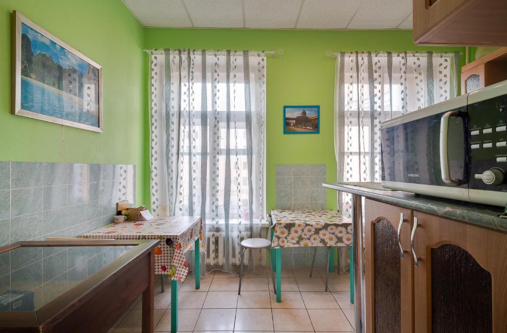 A kitchen or kitchenette at Яркий Дом