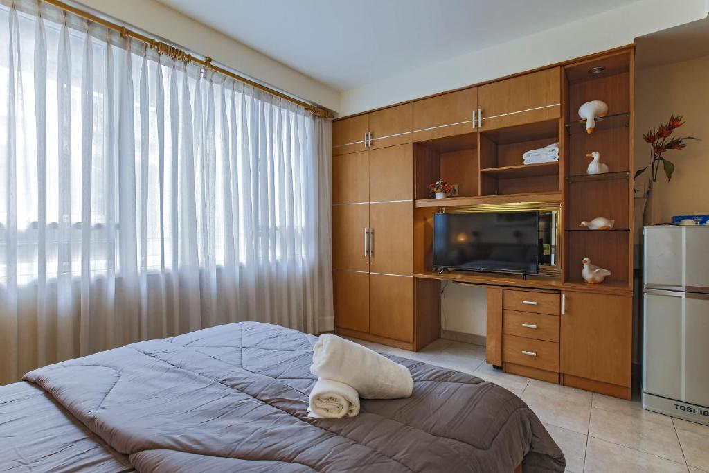 Giường trong phòng chung tại Homee House Saigon