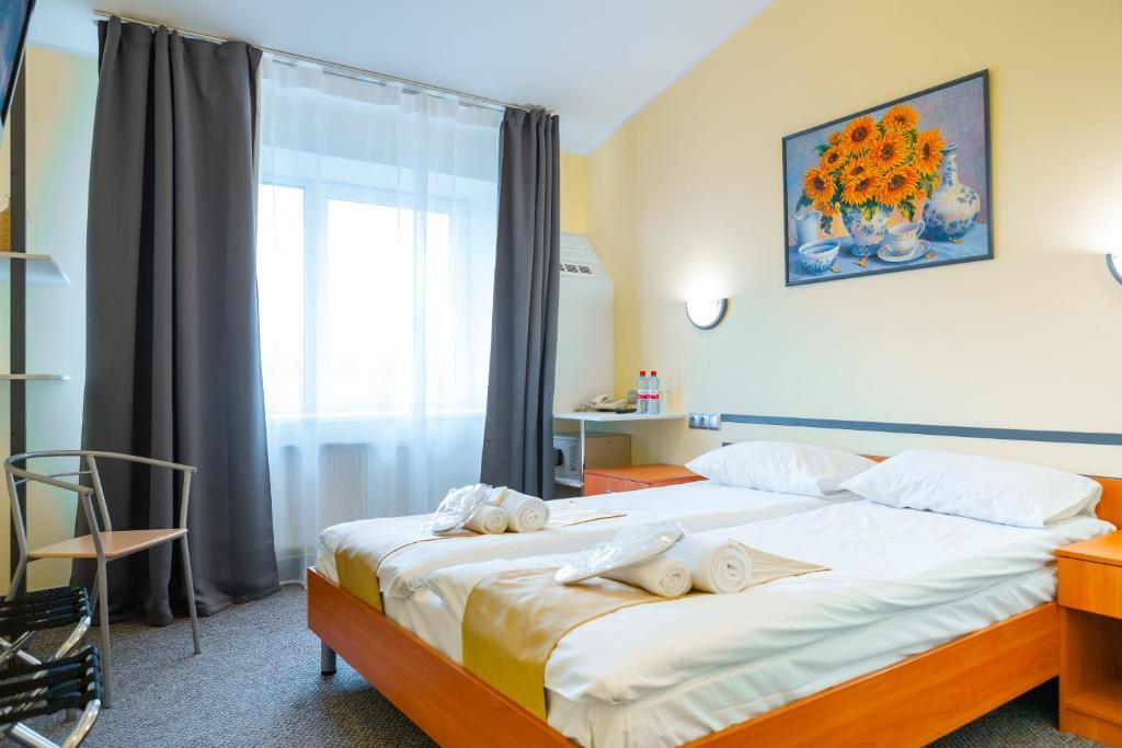 Кровать или кровати в номере Apart Hotel Tomo FREE PARKING