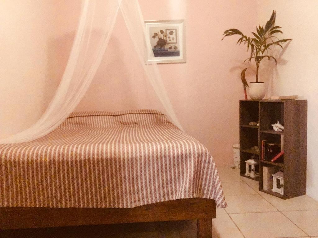 Cama ou camas em um quarto em Magical Garden