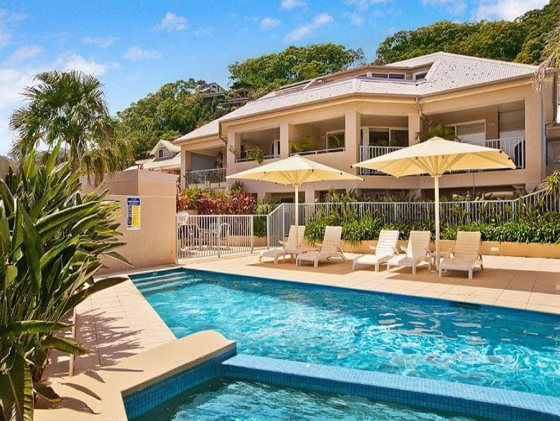 The swimming pool at or near Iluka Retreat Apartments @ Palm Beach