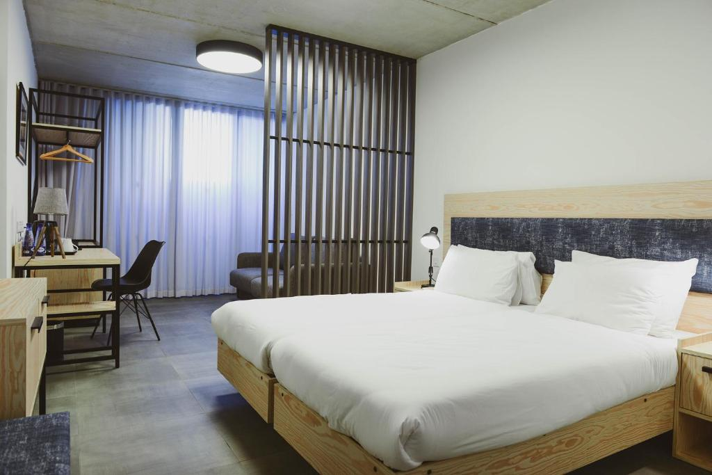 Cama ou camas em um quarto em Mr Todd Hotel