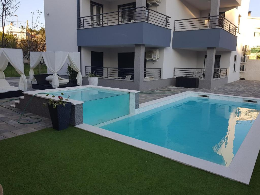 The swimming pool at or close to Apartments Marta