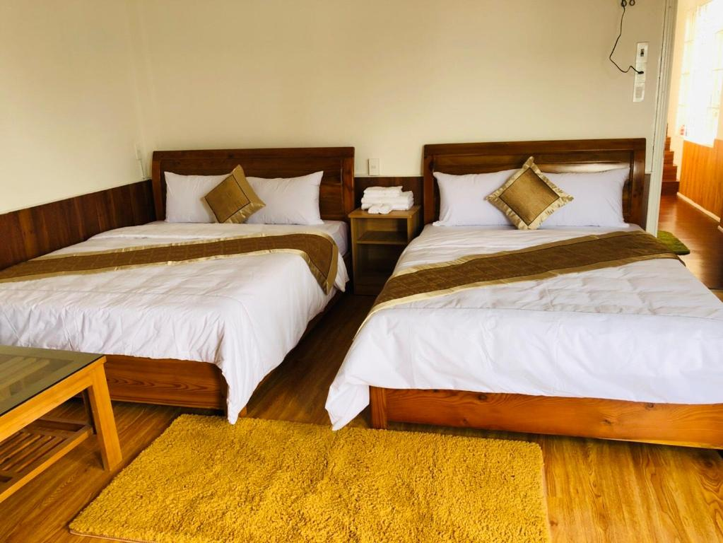A bed or beds in a room at Nguyen Hung Homestay