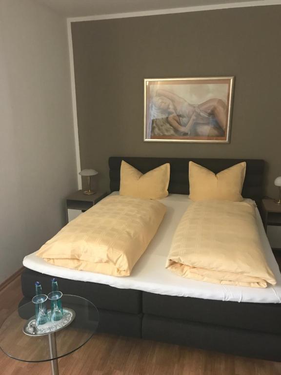 Ein Bett oder Betten in einem Zimmer der Unterkunft Gasthof Wulf