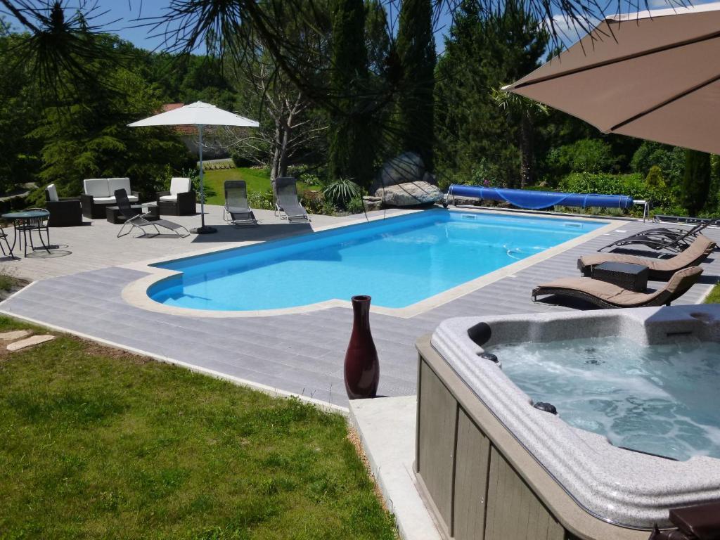 The swimming pool at or near Au Mas de Gamet