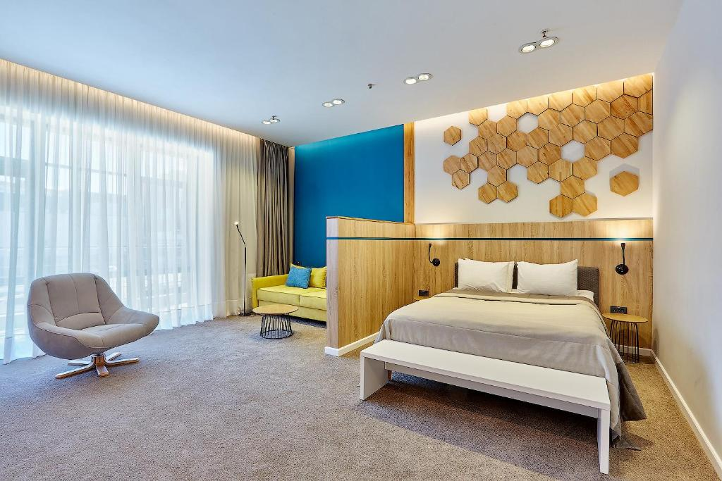 A bed or beds in a room at Aqua-Minsk Hotel Plus