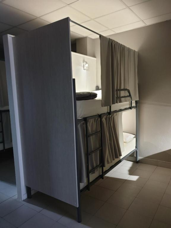 A kitchen or kitchenette at Albergue Porta Real