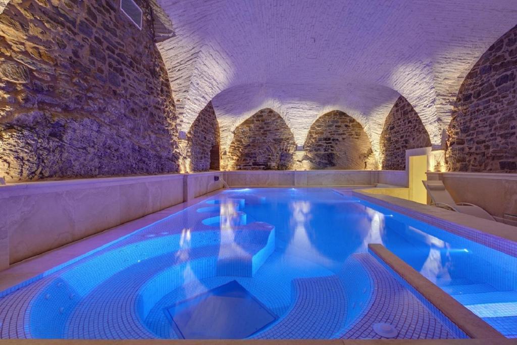 The swimming pool at or near Monastero Di Cortona Hotel & Spa