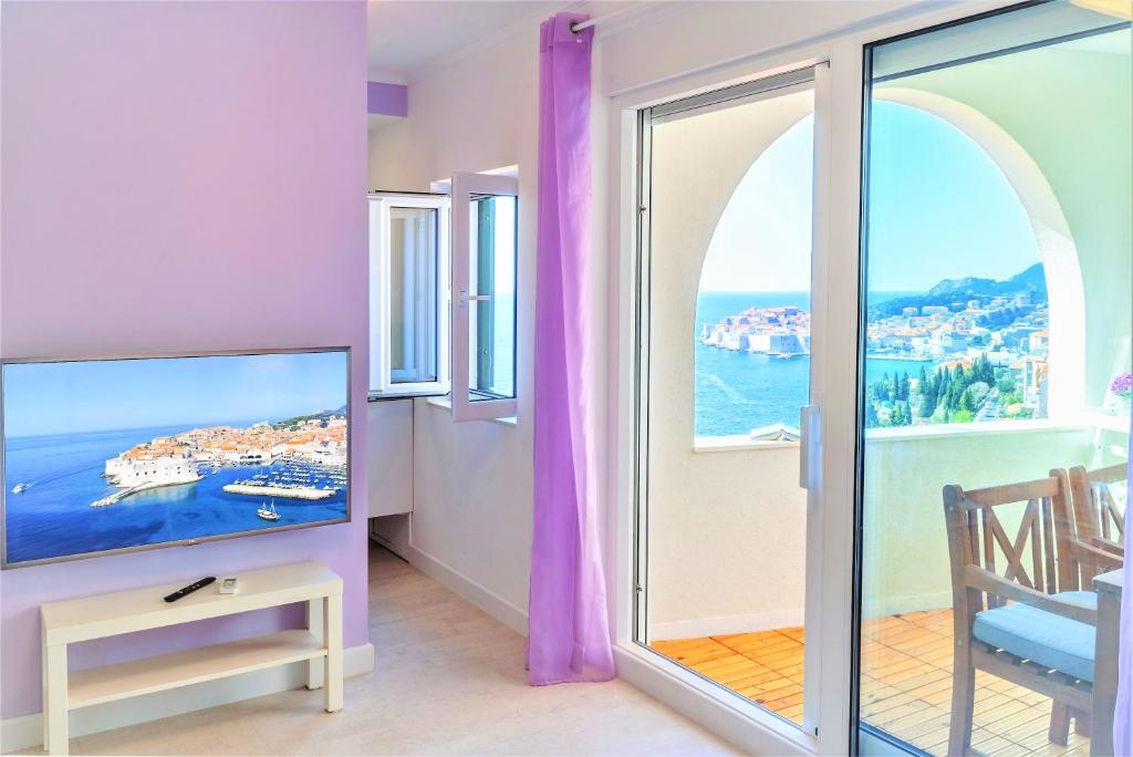 A television and/or entertainment centre at Dubrovnik Colors - Old Town View Apartment No1