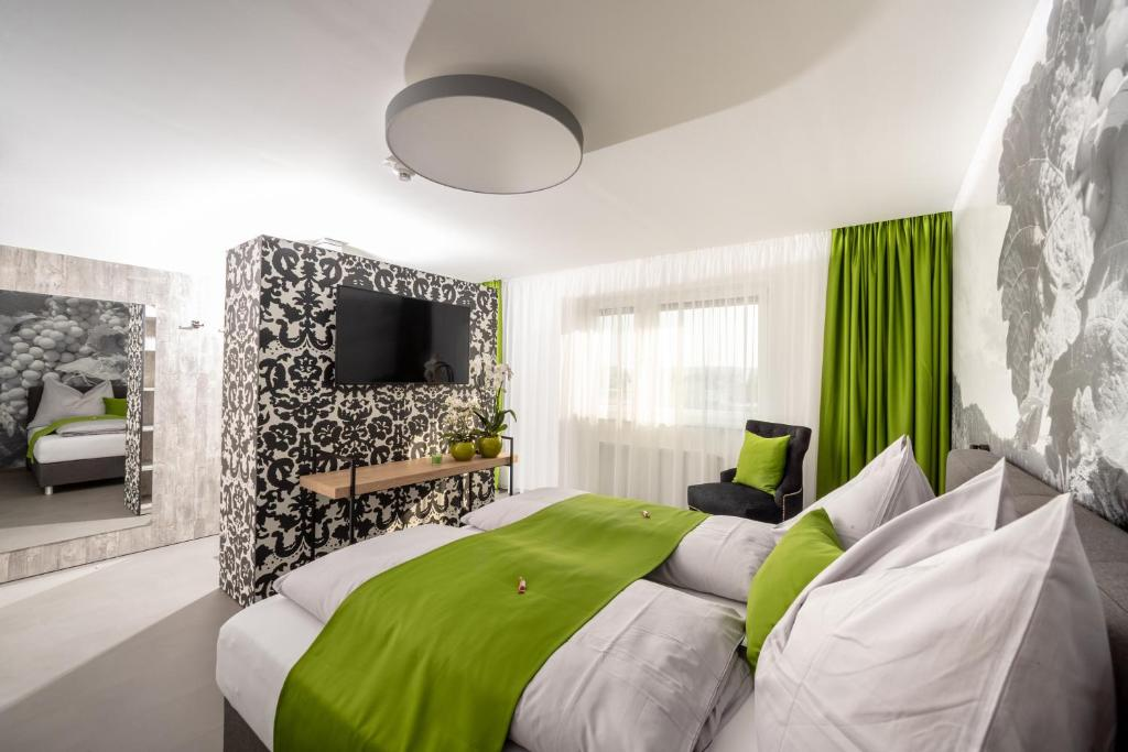 A bed or beds in a room at Hotel Greenrooms