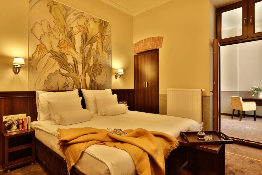 A bed or beds in a room at Hotel Amber Design