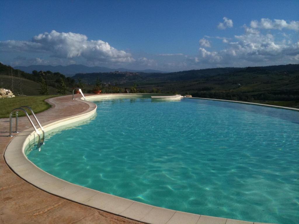 The swimming pool at or near Relais Poggio Del Sogno