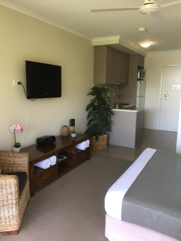 A television and/or entertainment center at Airlie Central Apartments