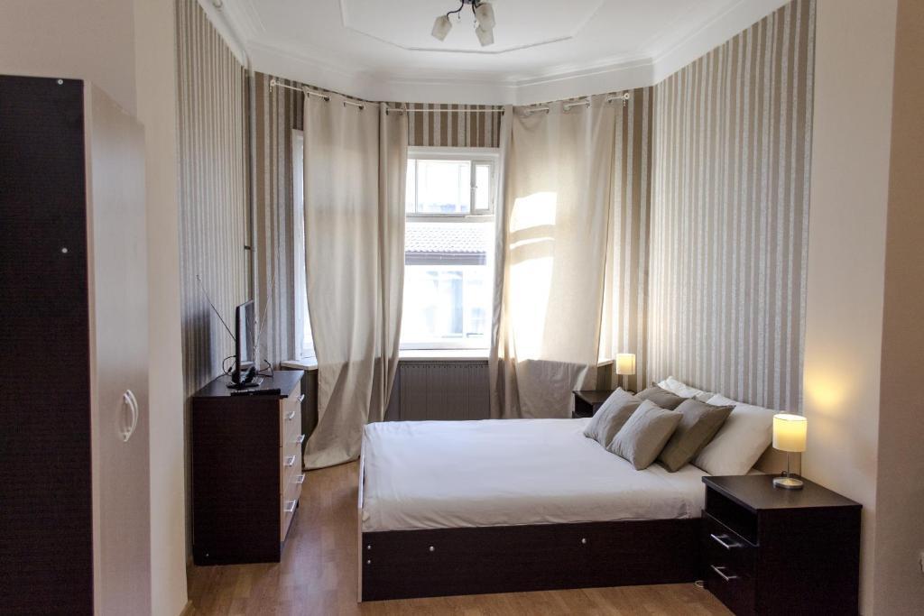Кровать или кровати в номере Вагнер