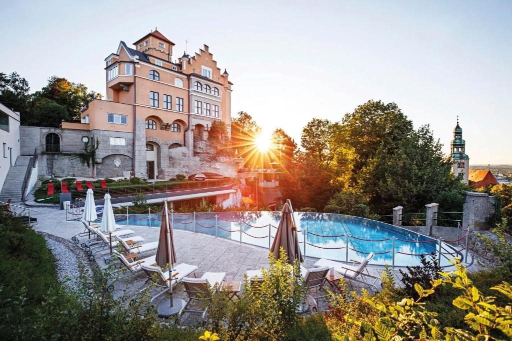 The swimming pool at or near Hotel Schloss Mönchstein