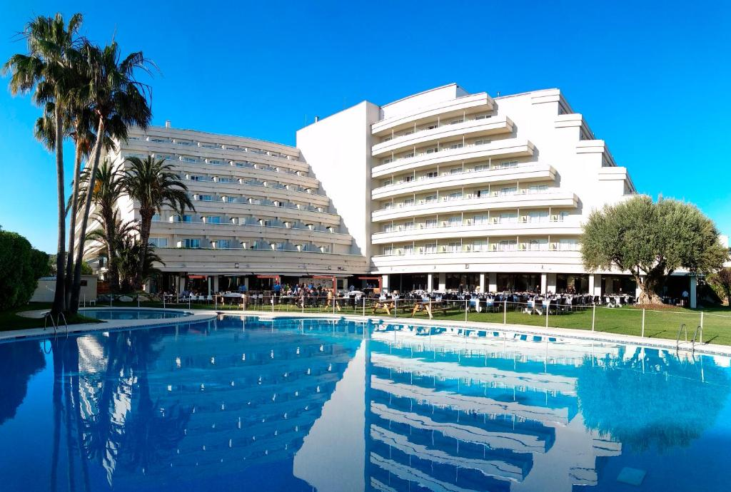 The swimming pool at or near Melia Sitges