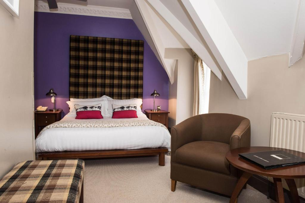 A bed or beds in a room at Forest Hotel