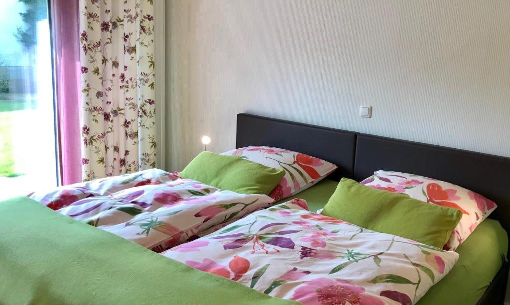 Ein Bett oder Betten in einem Zimmer der Unterkunft Inselferien Micheel