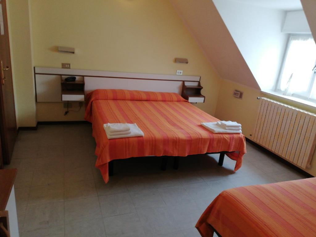 Letto o letti in una camera di Hotel Ambasciata