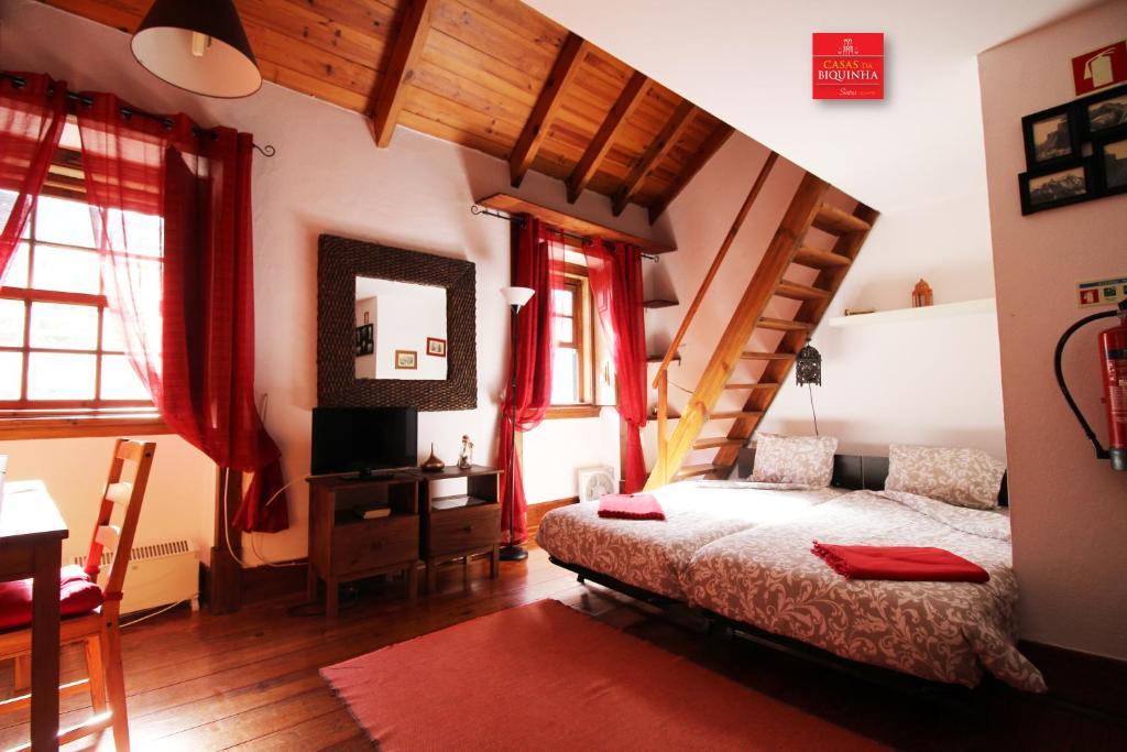 A bed or beds in a room at Casas da Biquinha