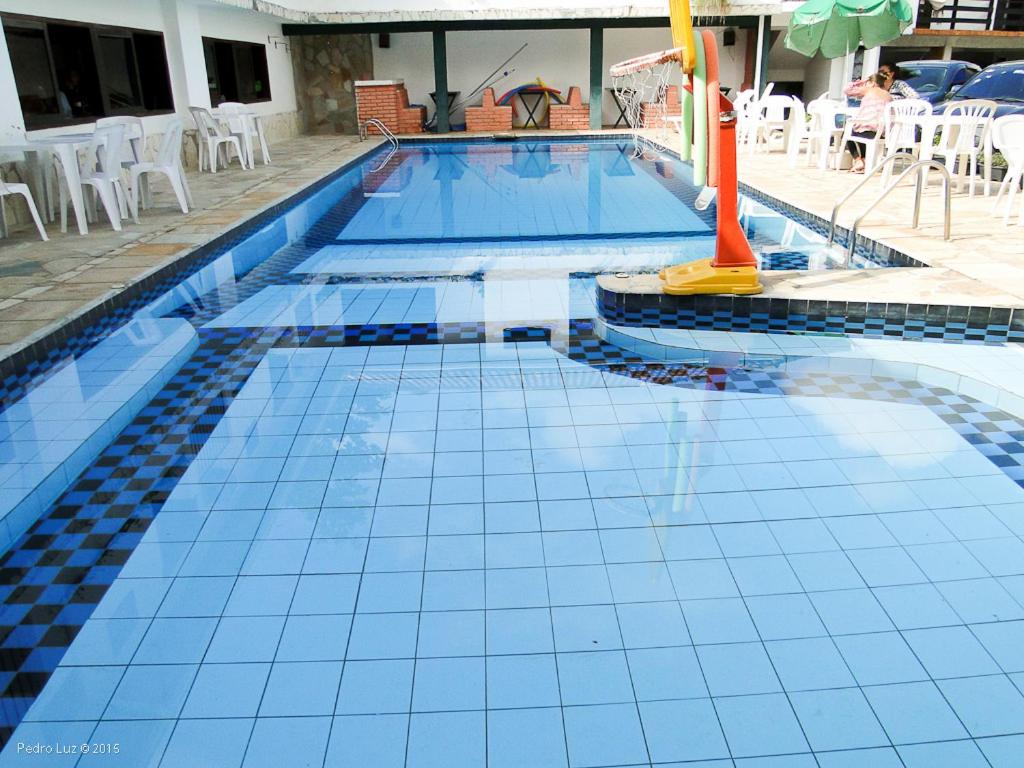 The swimming pool at or close to Hotel Halloween Inn Penedo