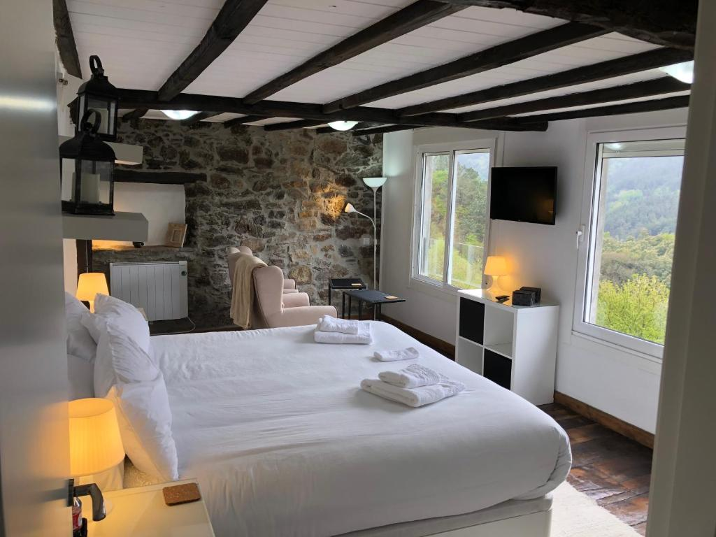 A bed or beds in a room at Casa Campacinas