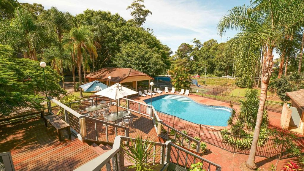 A view of the pool at Country 2 Coast Motor Inn Coffs Harbour or nearby