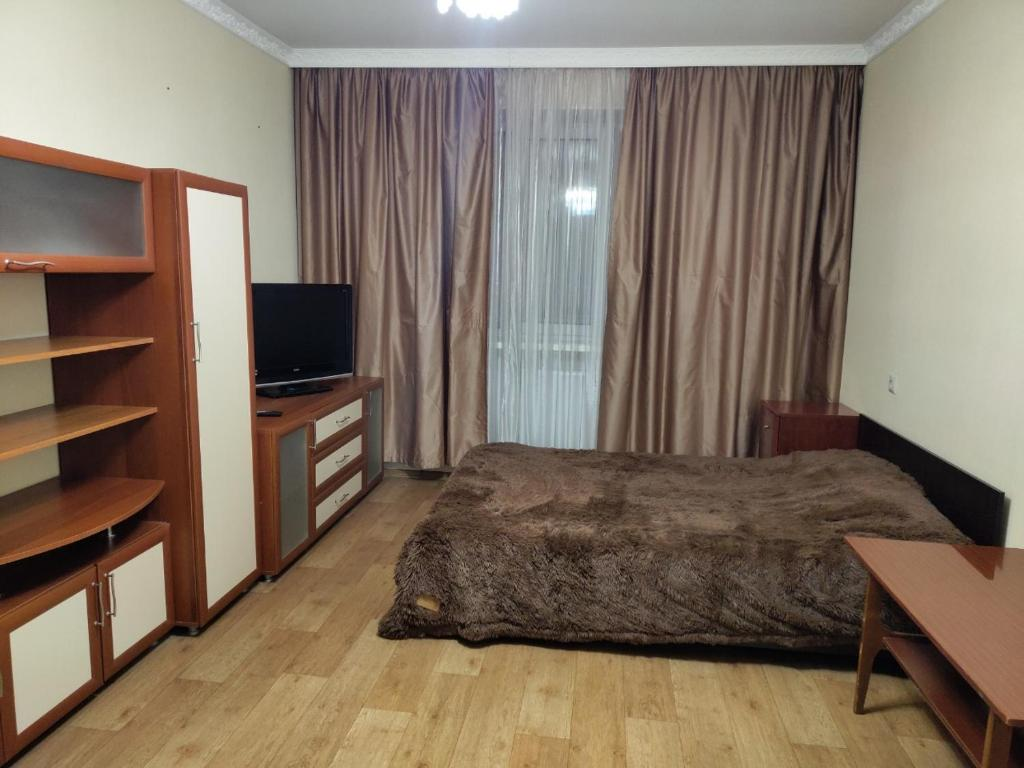 A bed or beds in a room at Apartment on Konstantina Ivanova 91