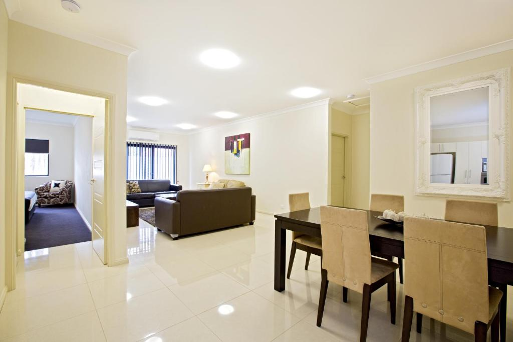 A seating area at Astina Serviced Apartments - Central