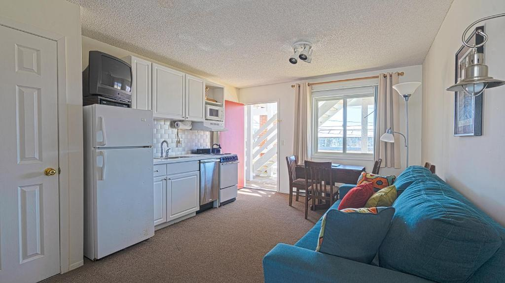A kitchen or kitchenette at Born Free Suites by the Sea