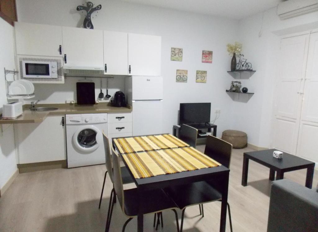 Una cocina o zona de cocina en Apartamentos Capuchinas