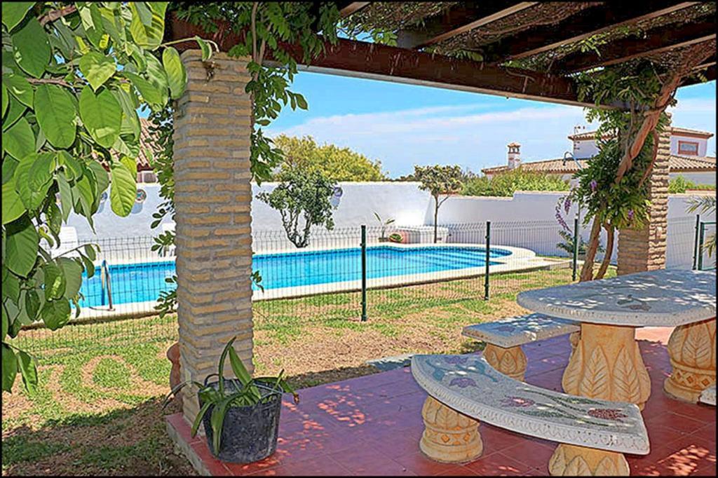The swimming pool at or near Bungalow Ramos II