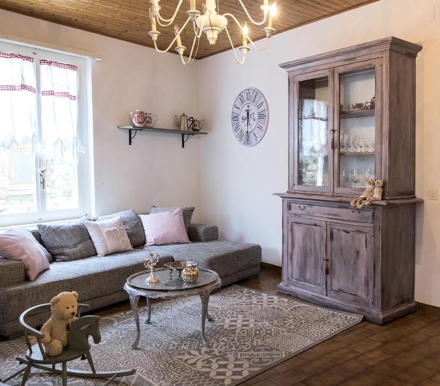 Area soggiorno di Casa Angiolina - Holidays - Appartamento Dolce Letargo