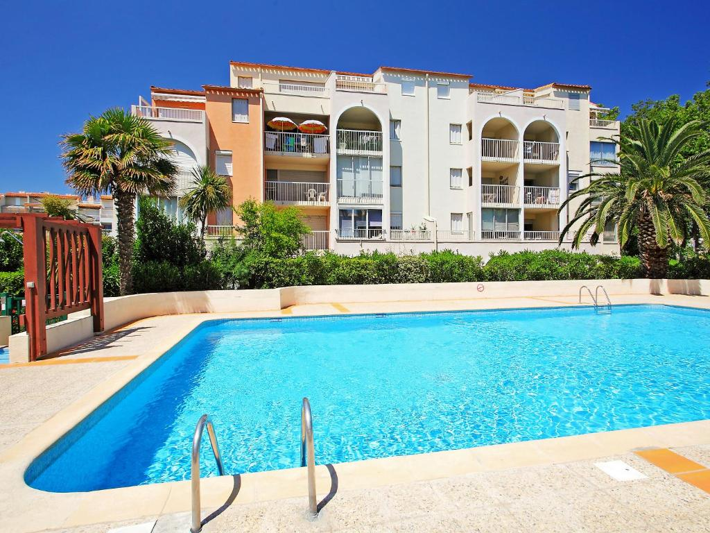 The swimming pool at or near Apartment Le Lagon Bleu-1
