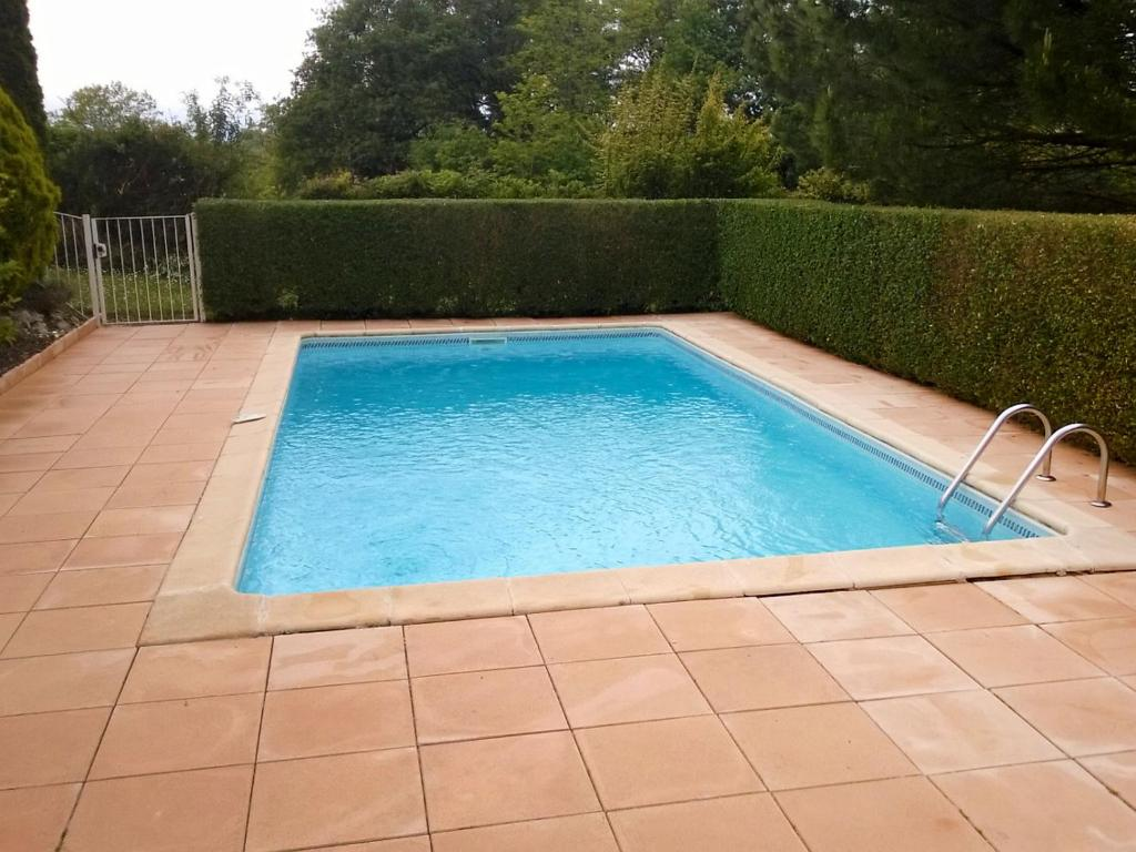 The swimming pool at or near Holiday Home La Maison Monceny