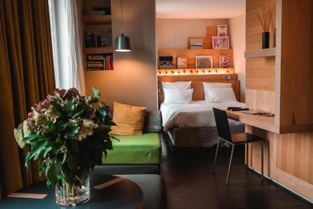 Un ou plusieurs lits dans un hébergement de l'établissement Le Citizen Hotel